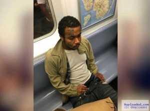 Man caught masturbating on a train while staring at a woman (photo)